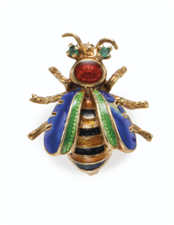 Enamel and Emerald Bee Brooch Designed as a gold bee with blue, green, black, yellow and red enamel and round emerald eyes early 1900s