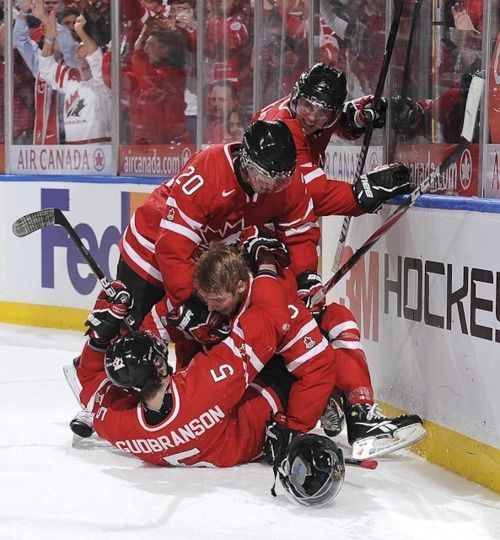 Team Canada, you're doing it wrong. Try to celebrate without getting concussed.