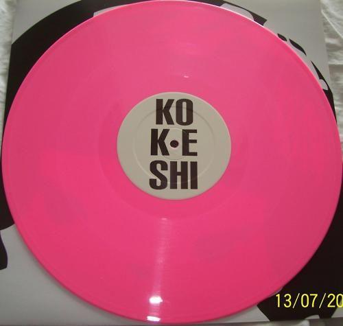 Kokeshi Pink Record.  via blossomgraphicdesign.blogspot.com