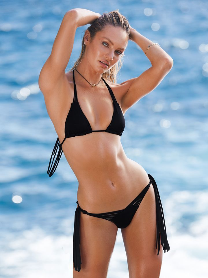 Victoria's secret model bridget malcolm poses in a skimpy black bikini