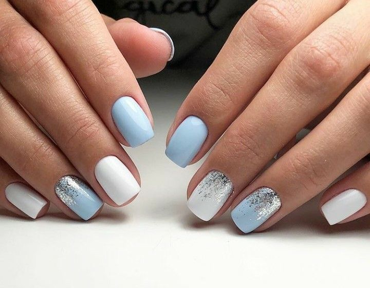 Baby blue, white, and silver glitter nails.