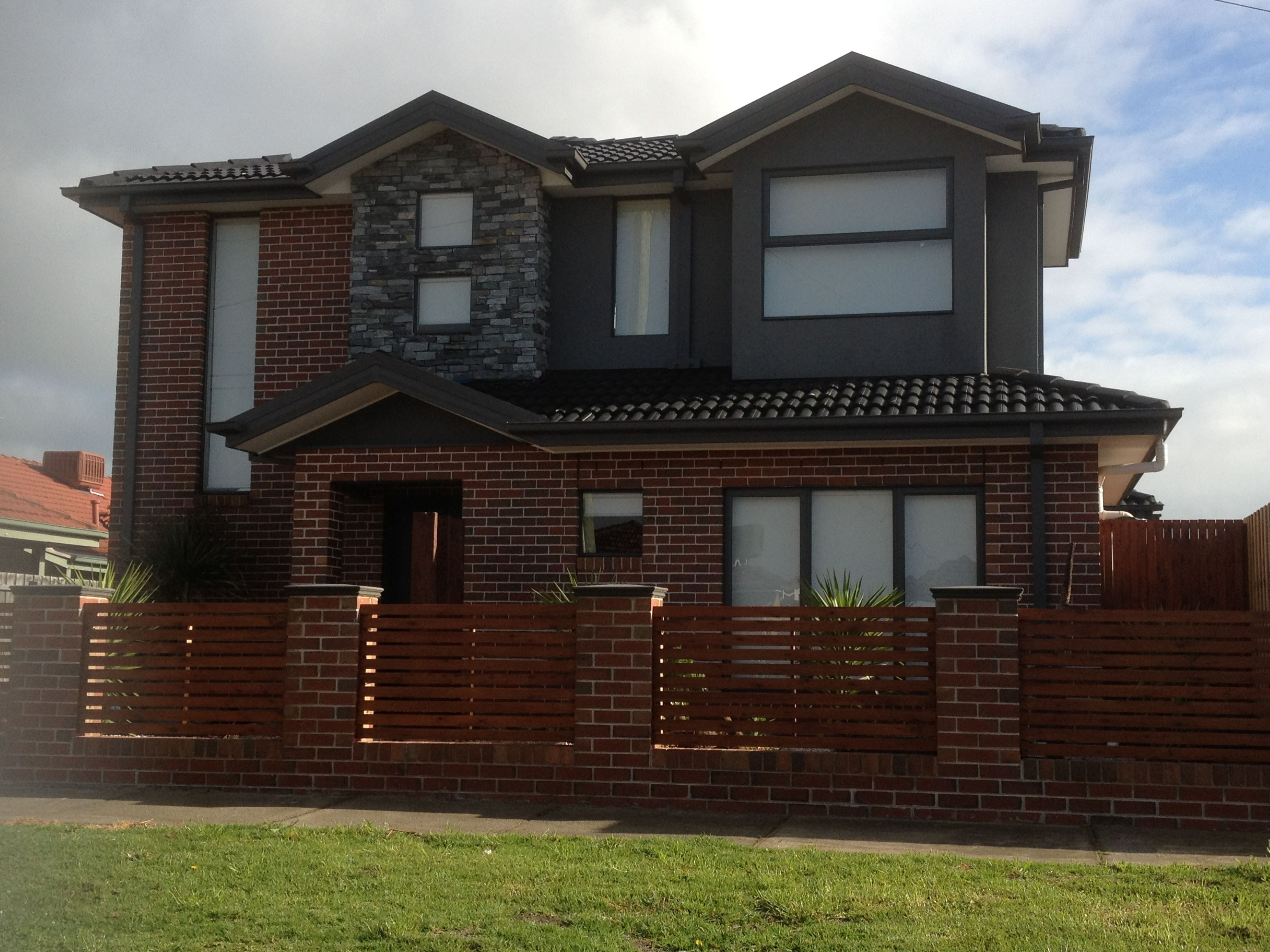 Combination Of Brick Render Stone And Timber Design
