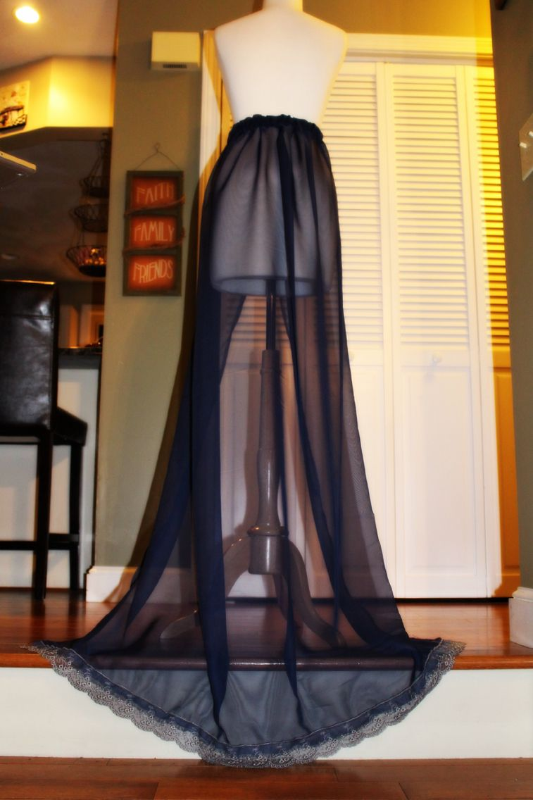Trailing navy blue chiffon skirt with grey Victorian lace along the hemming.