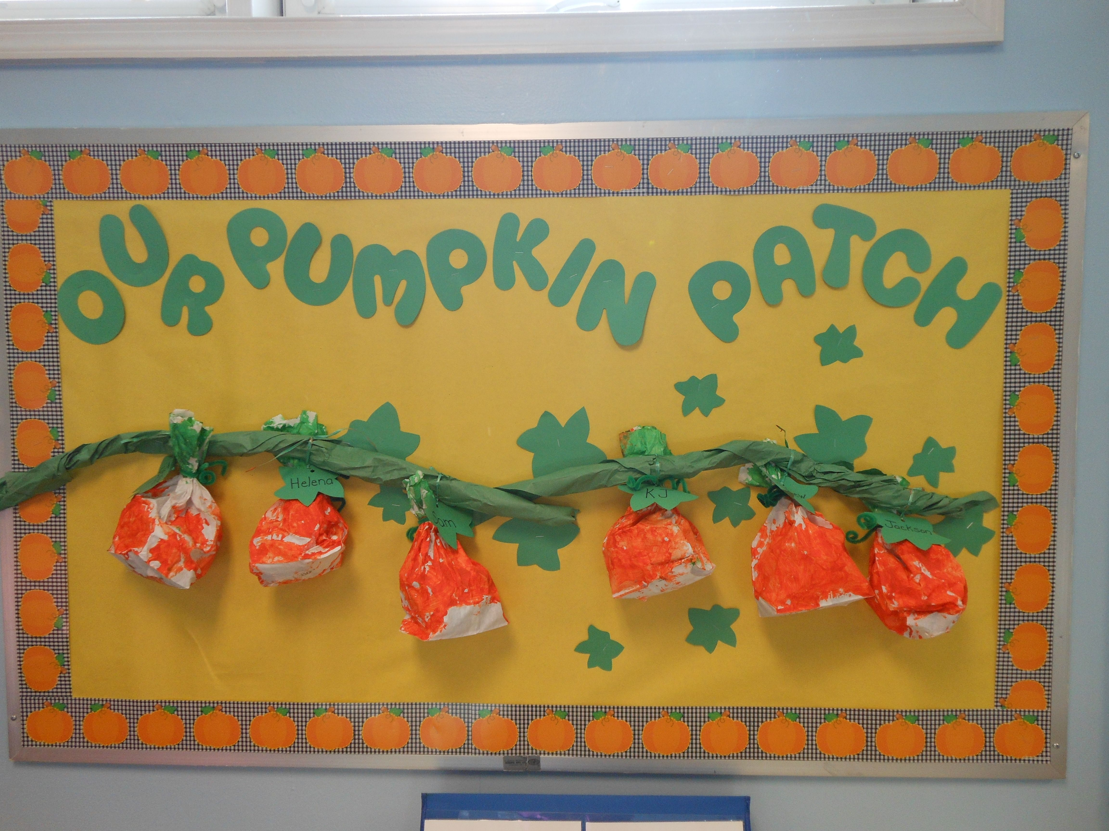 Our Pumpkin Patch bulletin board.   The pumpkins were made by the students using a paper bag stuffed with newspaper.  It was then tied with green curling ribbon and painted orange.  The vine was made using green bulletin board paper.  I wrote the children's names on construction paper leaves and tied them to the curling ribbon before attaching them to the vine. #pumpkinpatchbulletinboard Our Pumpkin Patch bulletin board.   The pumpkins were made by the students using a paper bag stuffed with n #pumpkinpatchbulletinboard