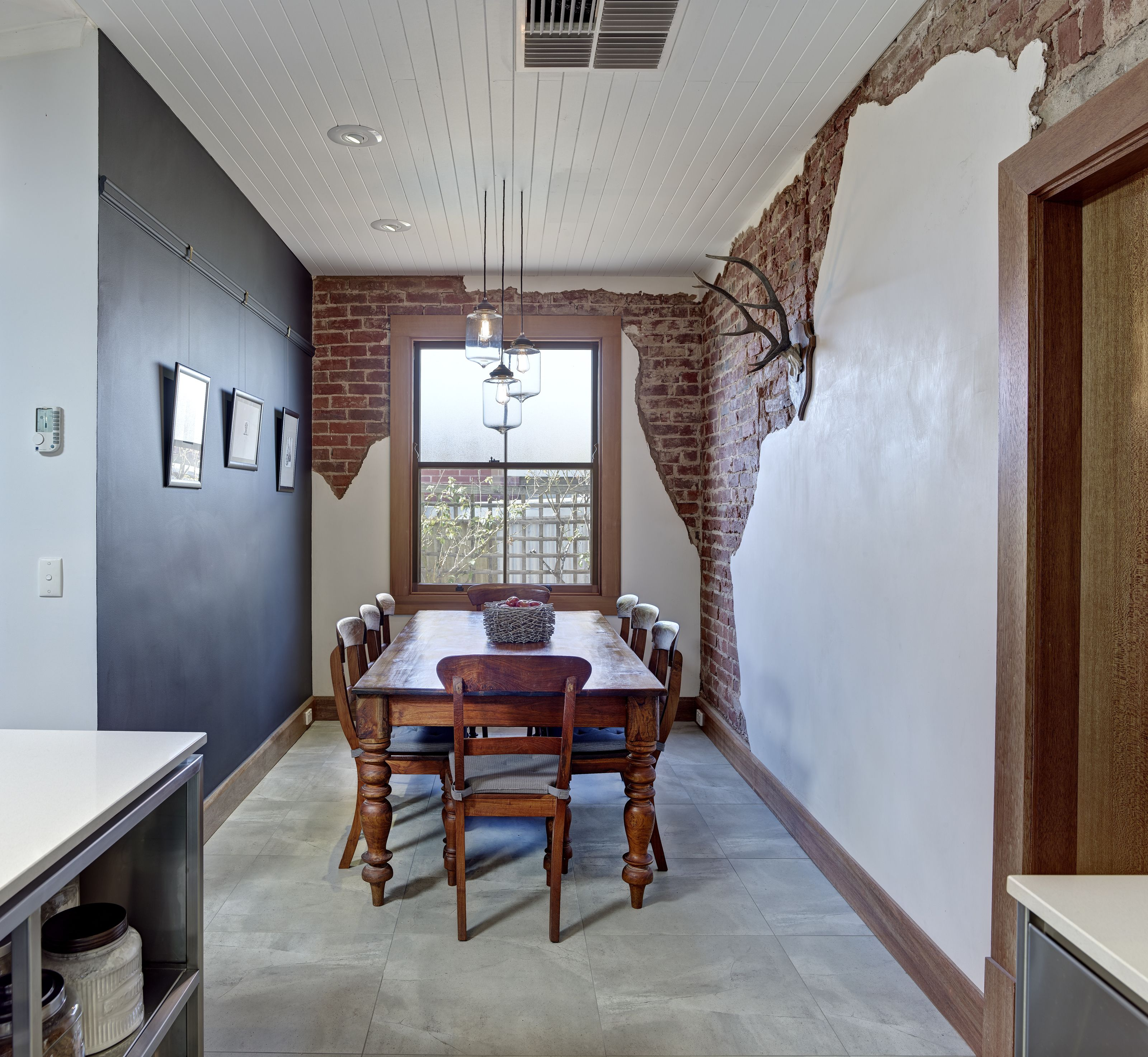 We partially exposed the red brick and painted a matt for Black wall interior