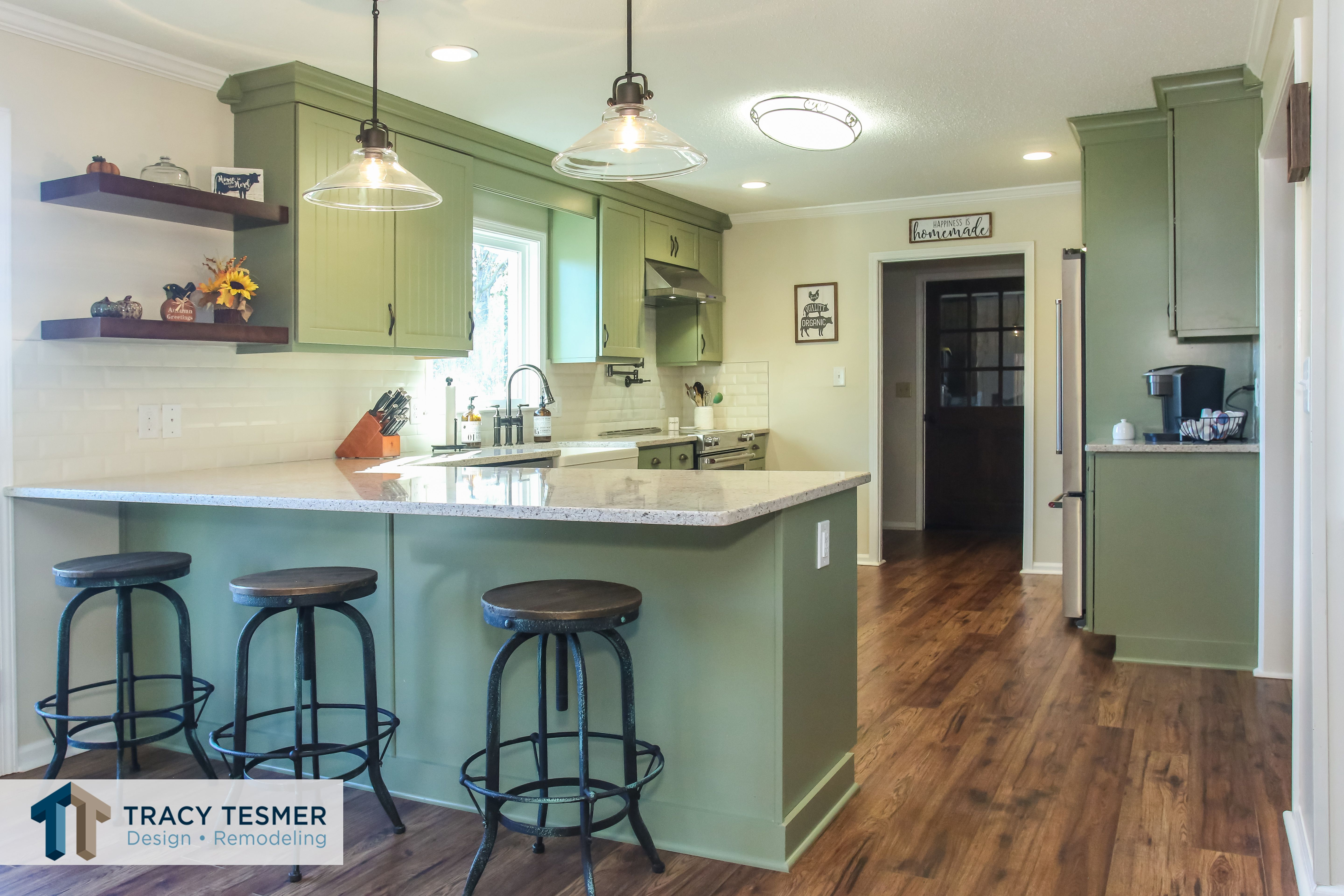 The Peninsula Bar Seating And Open Format Allow For Holiday Entertaining Needs Of Varyi Farmhouse Kitchen Remodel Home Remodeling Contractors Kitchen Remodel