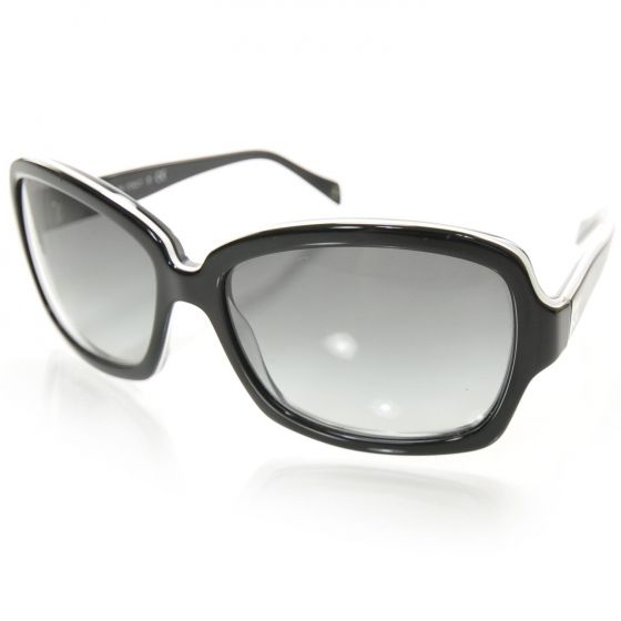 79d71c20fe These stylish sunglasses have large squared frames that are black facing  and have white edges with lenses ...