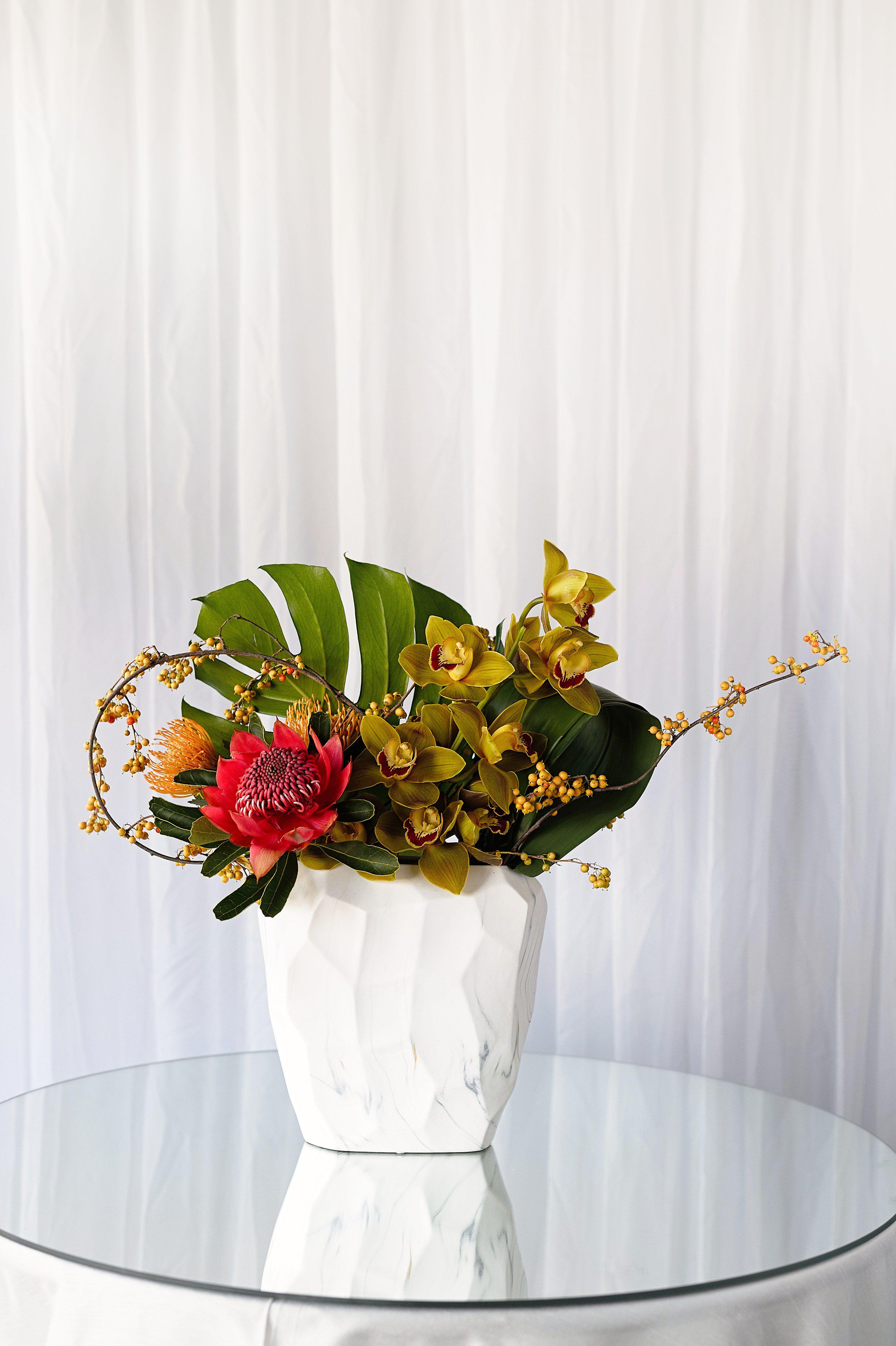 Pure Autumn Arrangement Modern Cymbidium Orchids And Protea