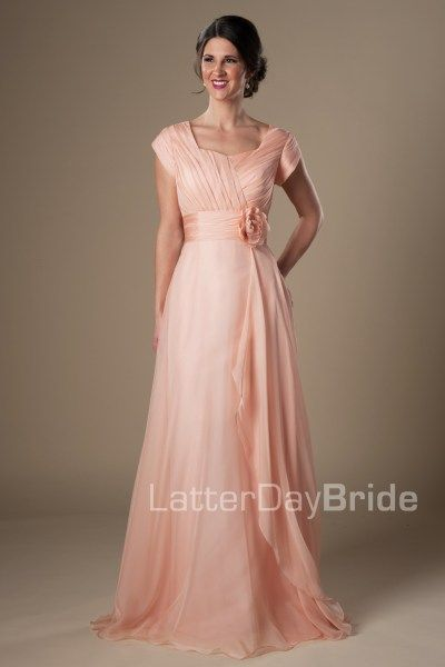 The Marley | This sweet modest prom dress features a lovely ruched bodice, thick flattering waistband complete with floral accent, and a flowy layered chiffon skirt. Dress available in Iris or Ice Coral *Pictured in Ice Coral Available at LatterDayBride.com or in Store At Latter Day Bride Located in Salt Lake City, Utah #modestprom