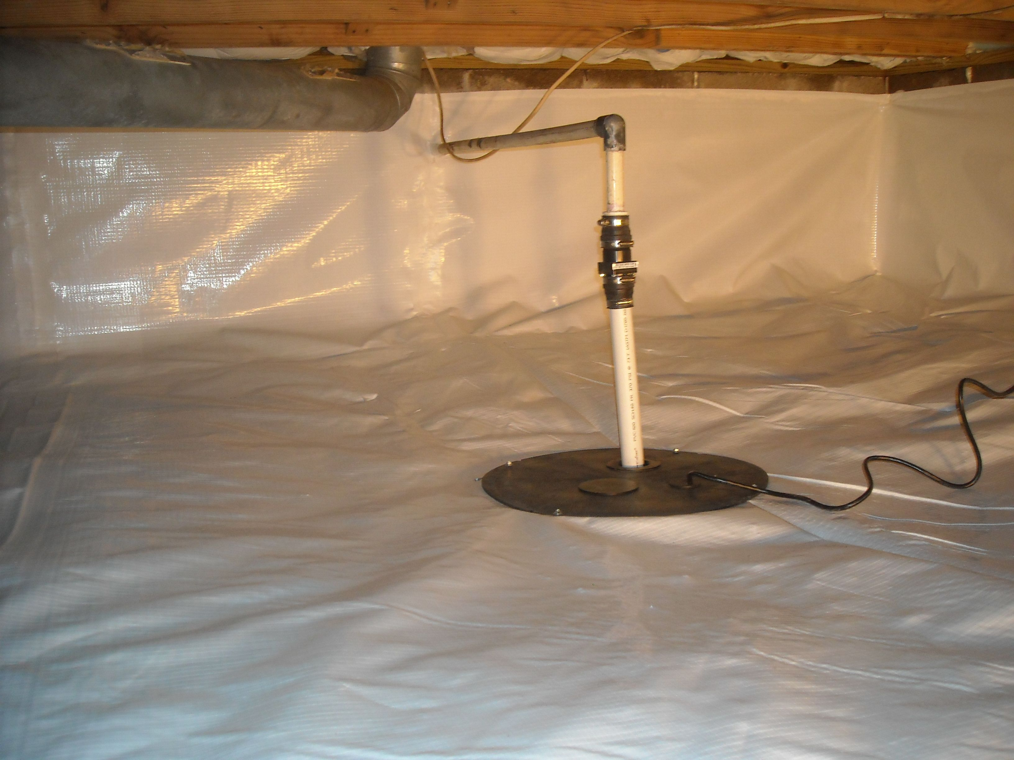 After picture of a sump pump in a crawl space
