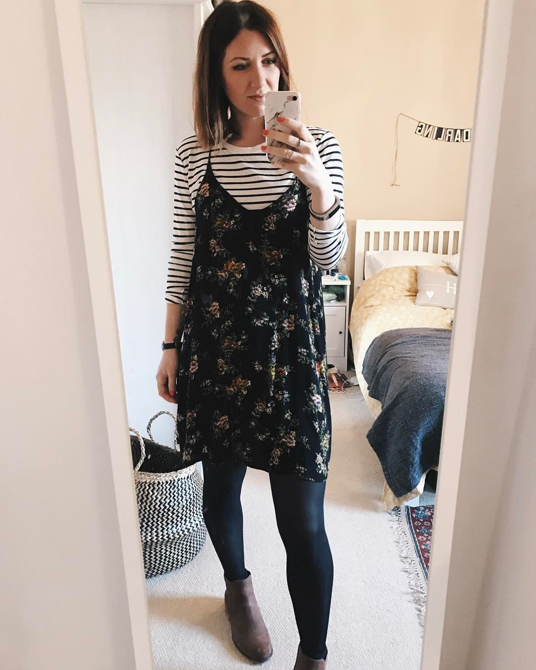 Layering. Floral slip dress by Urban Outfitters over a long sleeve strip top complete with tights and Boots. OOTD. Transition outfit - Hannah  (@hannahandtheblog) on Instagram