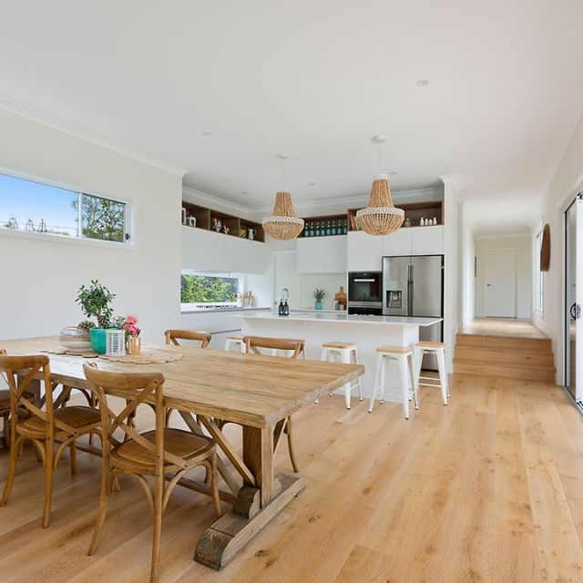 This spacious area is perfectly accompanied by its light wooden flooring and pendant lighting. Built by G.J. Gardner Homes Brookvale.
