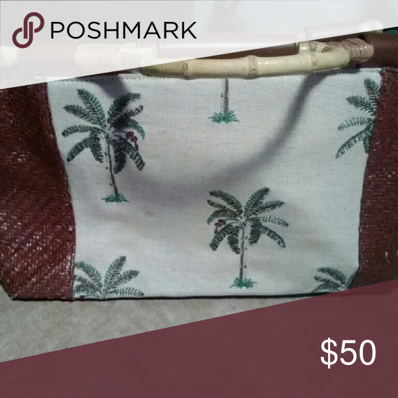 Palm tree purse This palm tree purse has a lot of storage on the inside with a cell phone holder and keychain has the wooden handles on it with leather sides Bueno Bags Shoulder Bags