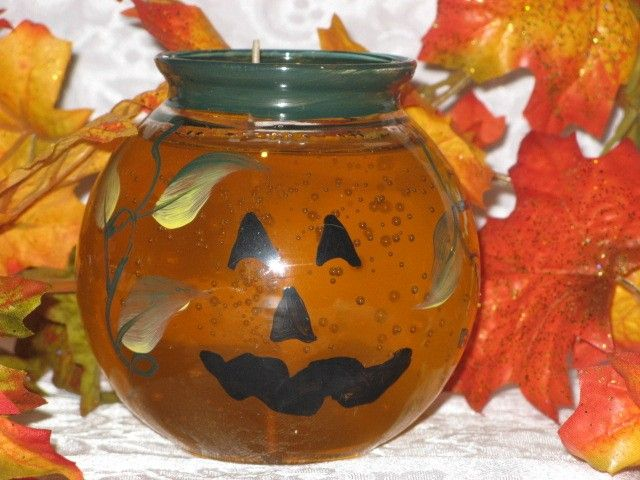 This Glass container is handpainted with the pumpkin face and some vines and leaves. The container is filled with orange candle gel and smells like pumpkin spice.