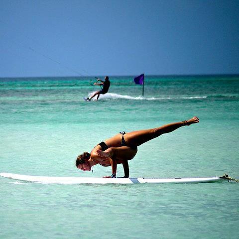 sun salutation indeed yoga on a paddleboard  paddle