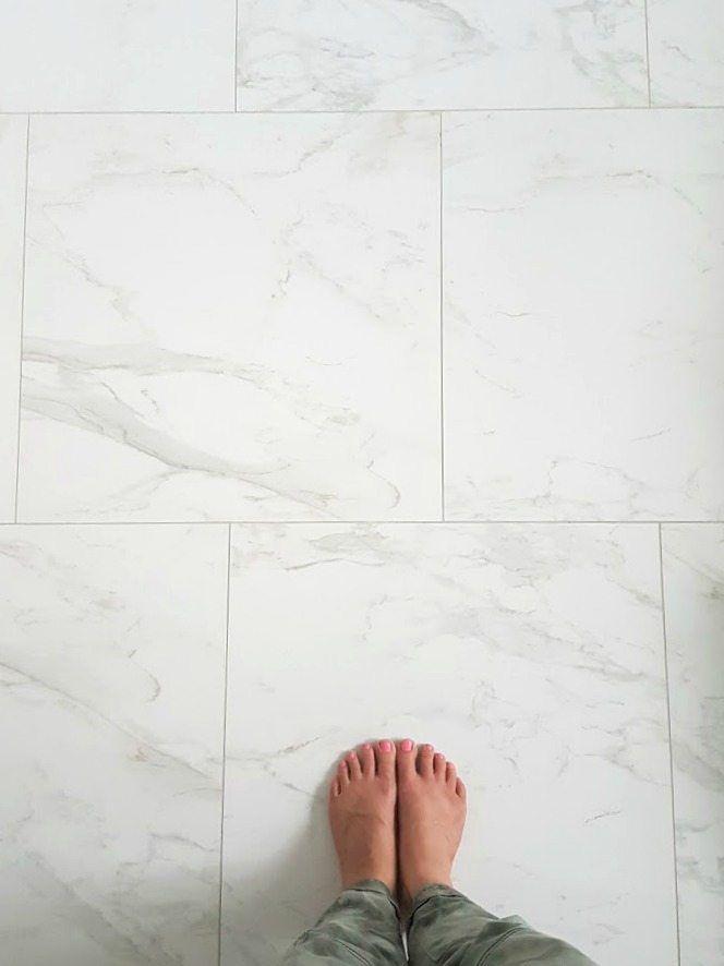 Photo of Choosing (faux) Carrara Marble Floor Tile for the Bathroom