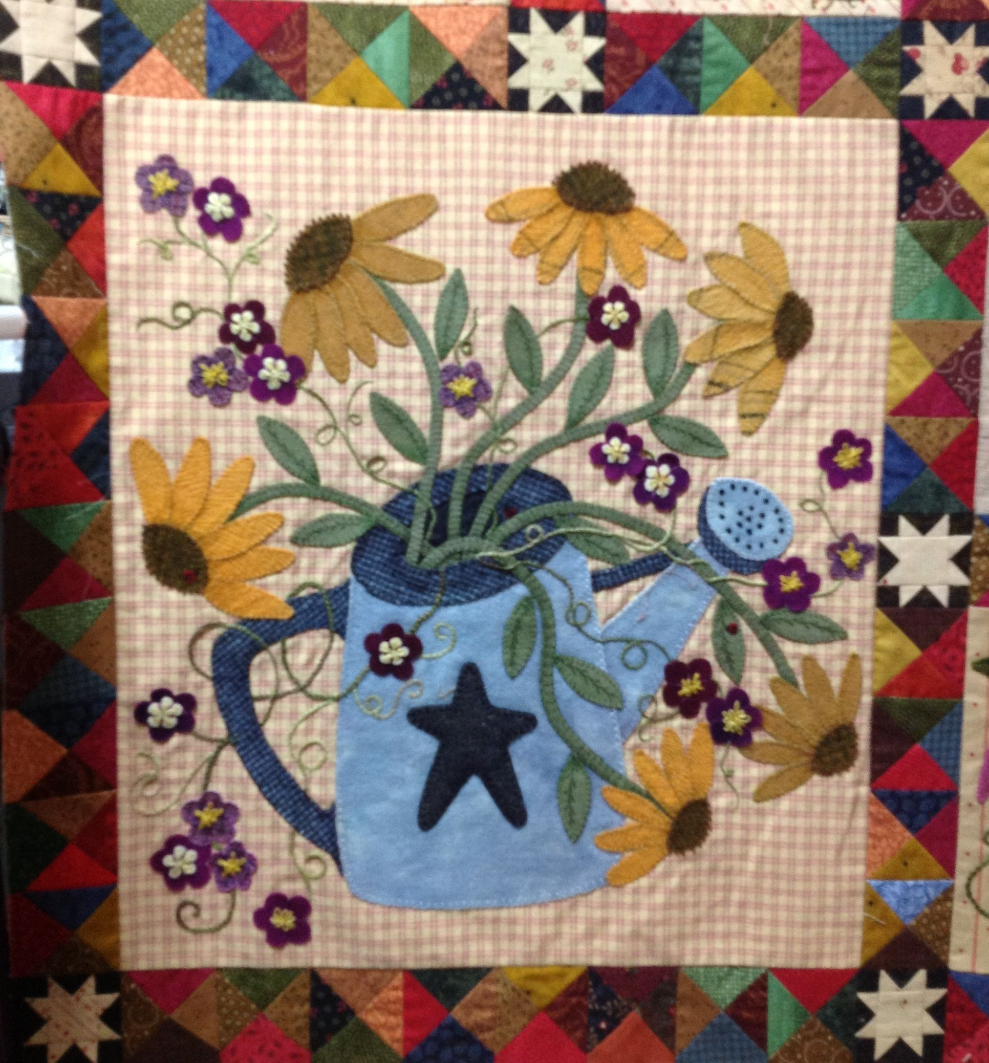 My Finished Watering Can Block Pattern From Primitive Gatherings Titled A Primitive Garden Block Made By Rho Flower Quilts Primitive Quilts Sunflower Quilts