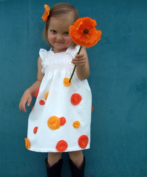 Poppy dress tutorial.  I also like the dress the model is wearing in the tutorial -- when the measurements were taken. :)