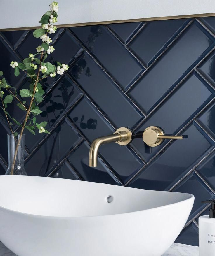 Sophisticated splashback with dark navy blue tiles laid in a herring bone pattern #bathroomsplashback Sophisticated splashback with dark navy blue tiles laid in a herring bone pattern #bathroomdark