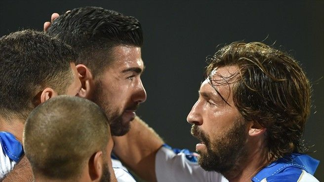 Graziano Pellè (C) of Italy celebrates with team-mates after scoring the opening goal during their UEFA EURO 2016 qualifier against Malta