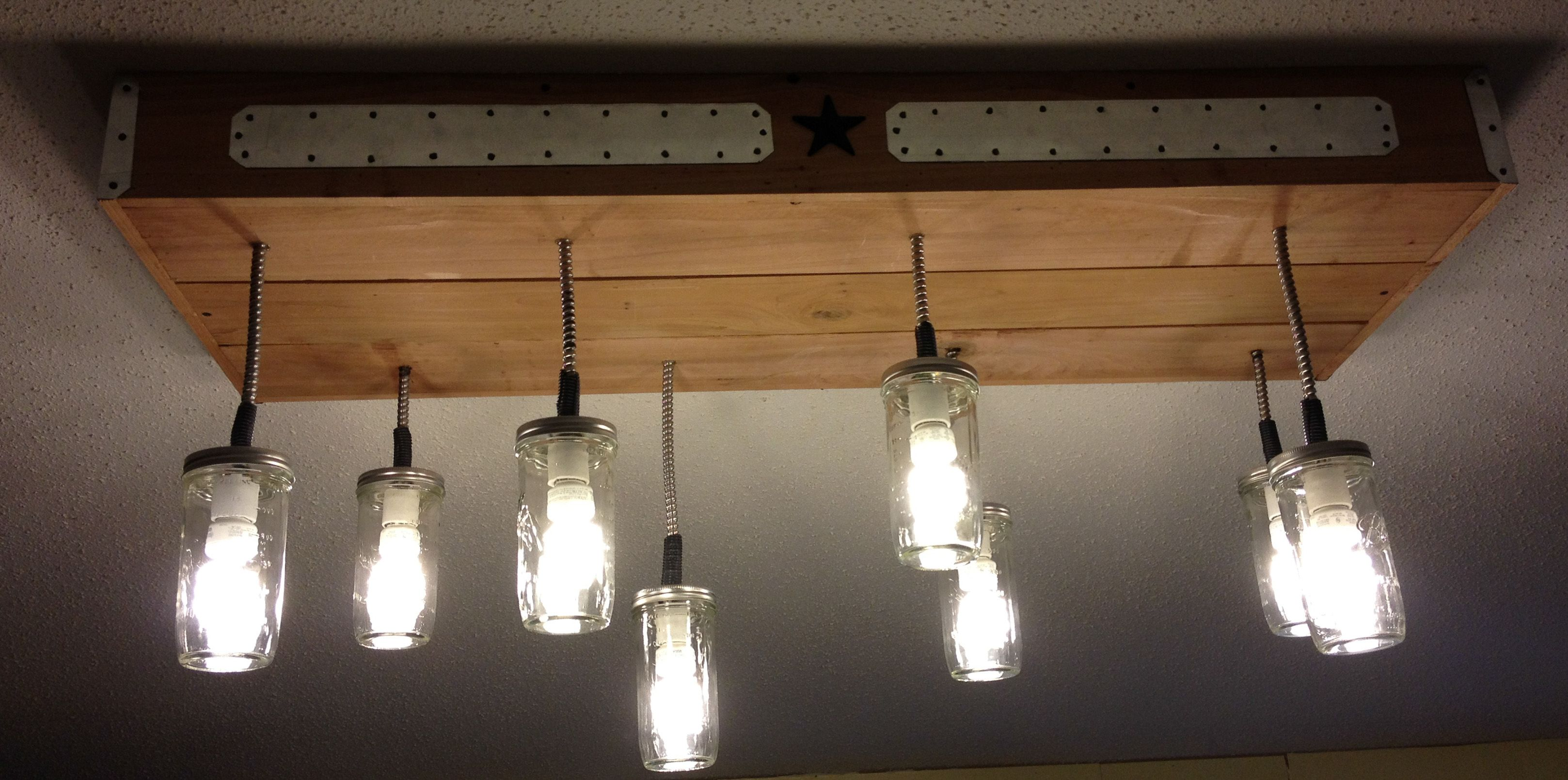 Light fixture my husband made to replace the long fluorescent lights in the kitchen.  Kitchen