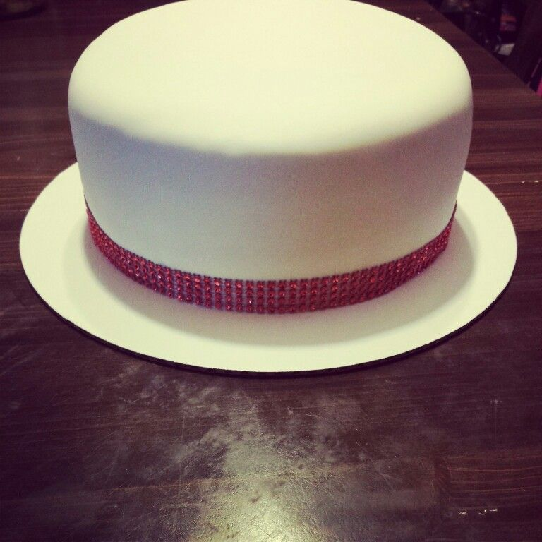 Strawberry cake with white fondant and red bling ribbon