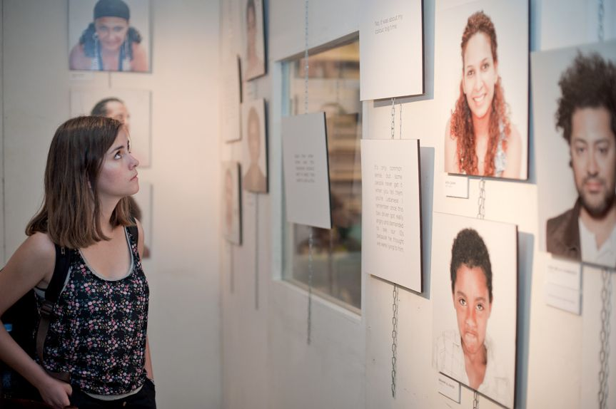 Woman looking at photographs from the Mixed Feelings exhibition at AltCity, September 24, 2014, Beirut. Photo by Marta Bogdanska