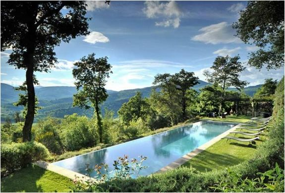 The spectacular Villa Arrighi is part of the private estate of Castello di Reschio, a collection of luxury villas in Umbria, Tuscany