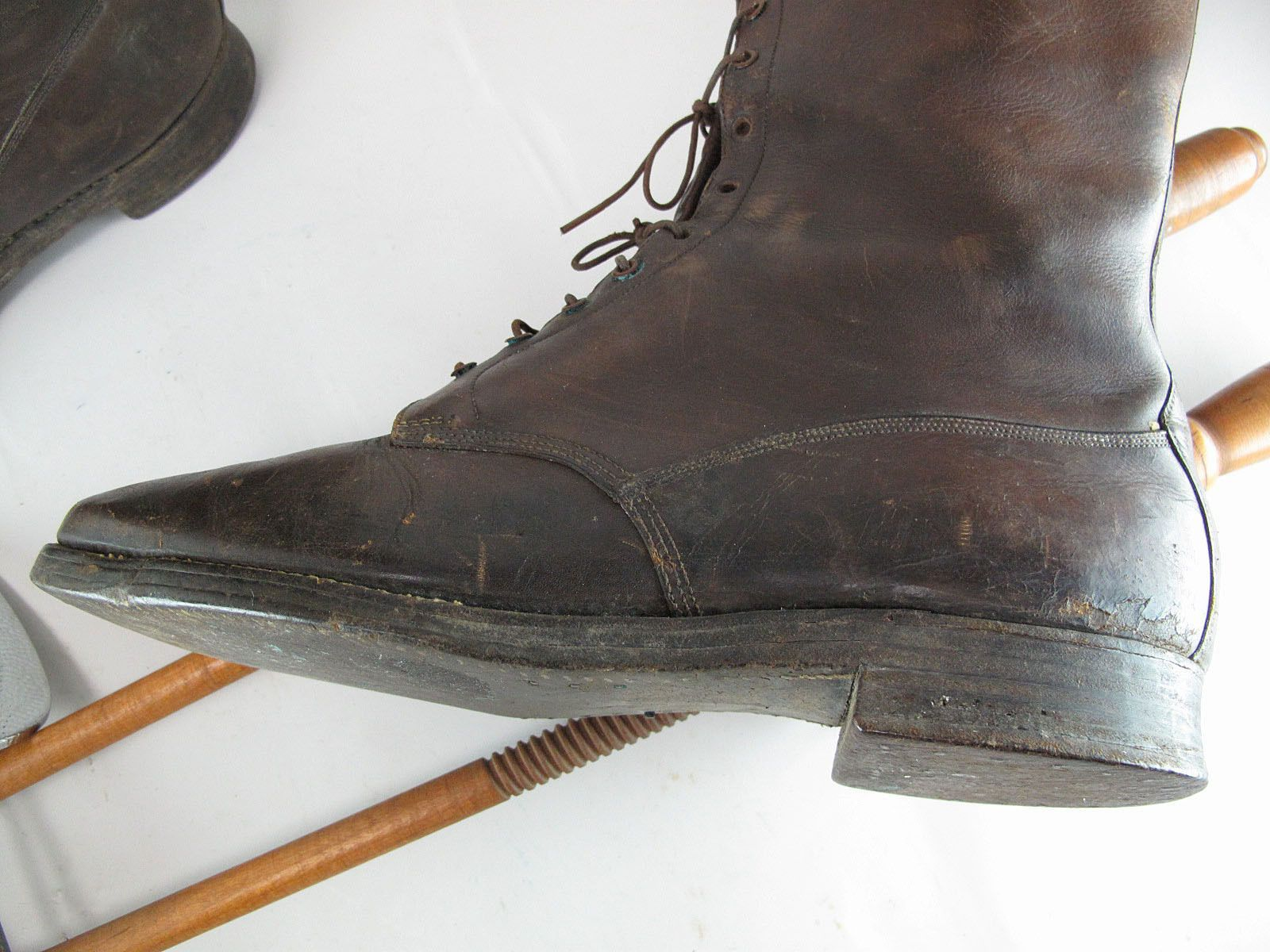 """Each of these rare boots has 22-eyelets in front, 10-eyelets on the inner side on top, stacked outsoles and two stitched-in canvas pull-straps inside. They are stamped """"Hanan & Son"""" with other stamps including a 10 1/2 size designation and the numbers """"2065 1K,"""" and come with a pair of wood and metal trees that were found with them. 