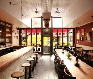 White subway tiles, industrial bar stools and red walls in the Meatball Shop in NYC