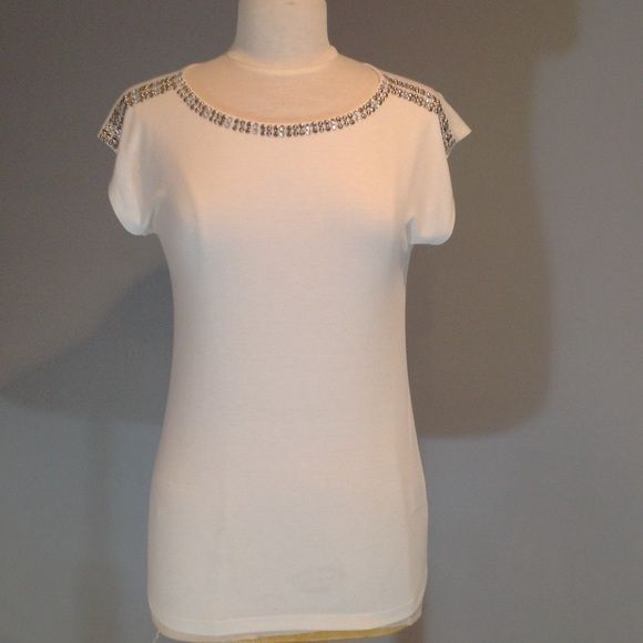 White embelished t-shirt Beautiful embelished t-shirt by Ruby Rd. Never worn but no tags on it. Size is marked xs but definitely runs big fits more like a small or med. super stretchy too. Love this top it's just to big for me. 😥 Ruby Rd.  Tops Tees - Short Sleeve