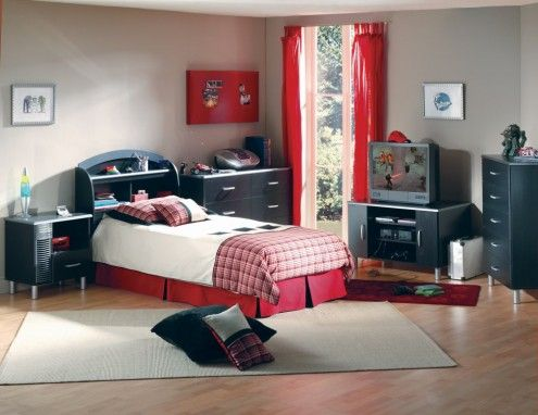 Blue, white, and red, boys bedroom. I would have black furniture instead.