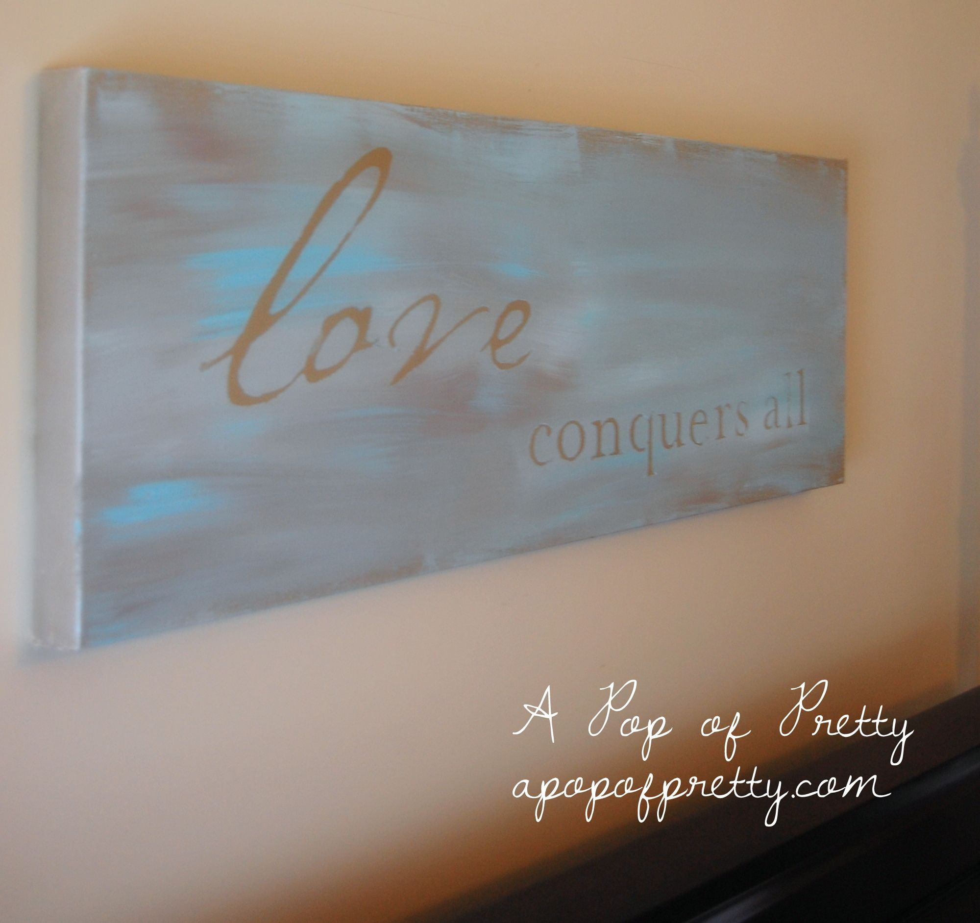Diy wall art love conquers all painted canvas love for Inspirational quotes painted on canvas