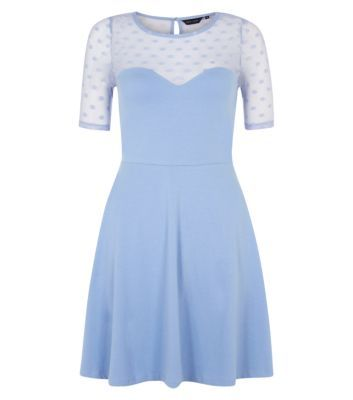 This pale blue dress is the perfect work-wear to evening look. Wear pale blue heels to match.- 1/2 sleeves- Fit and flare design- Rounded neckline- Semi sheer mesh detailing- Stretch jersey fabric- Dress length: 34