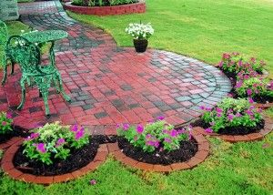 Love this idea!!! Would be great with a rose planted in each round....For my next patio....