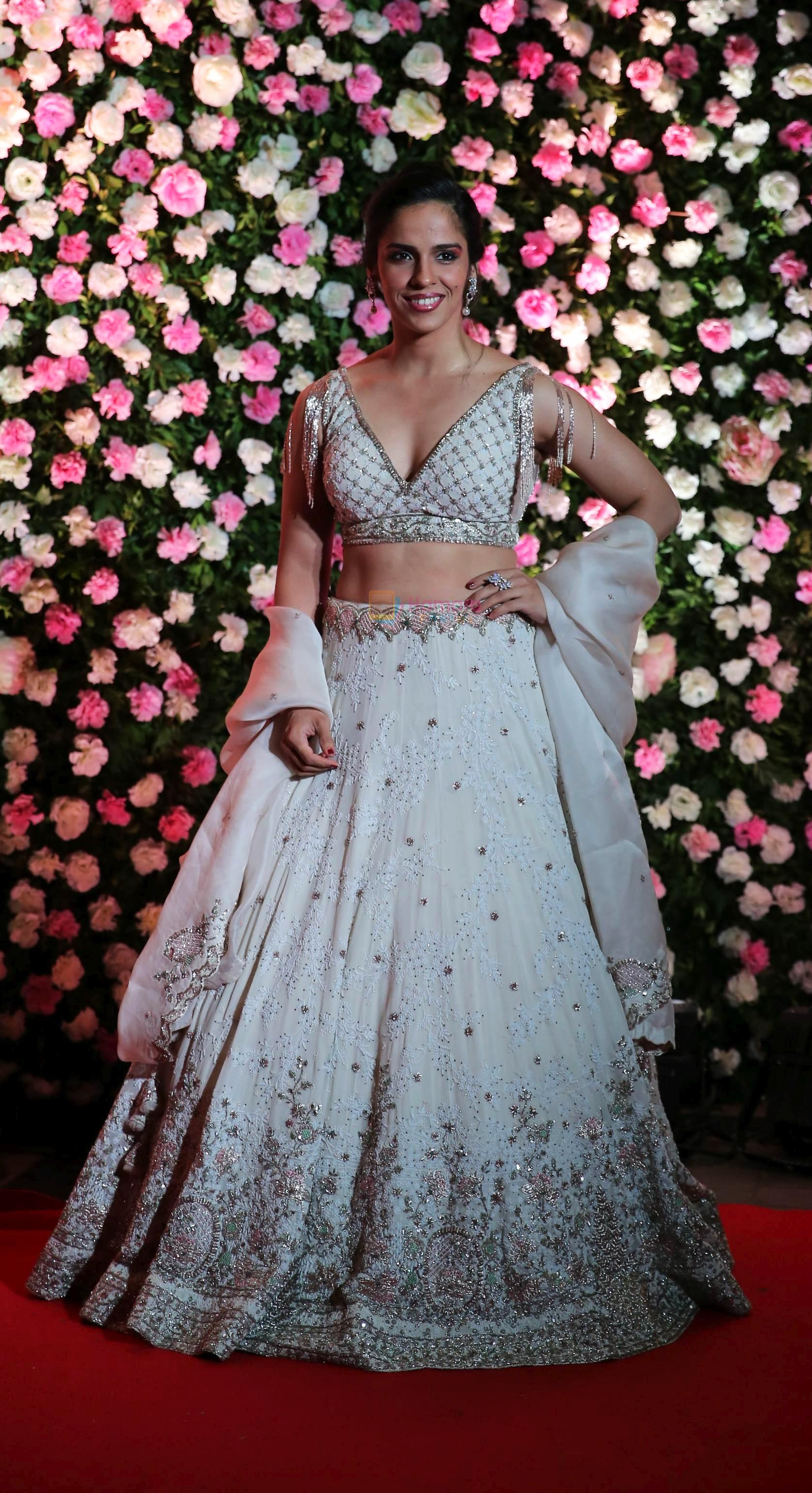 Saina Nehwal looked lovely in a white designer lehenga at