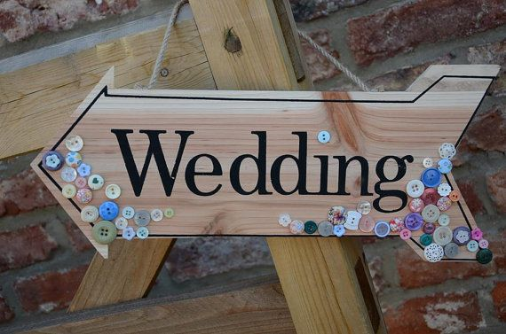 Wooden Wedding sign in a arrow shape with button by maxollieandme