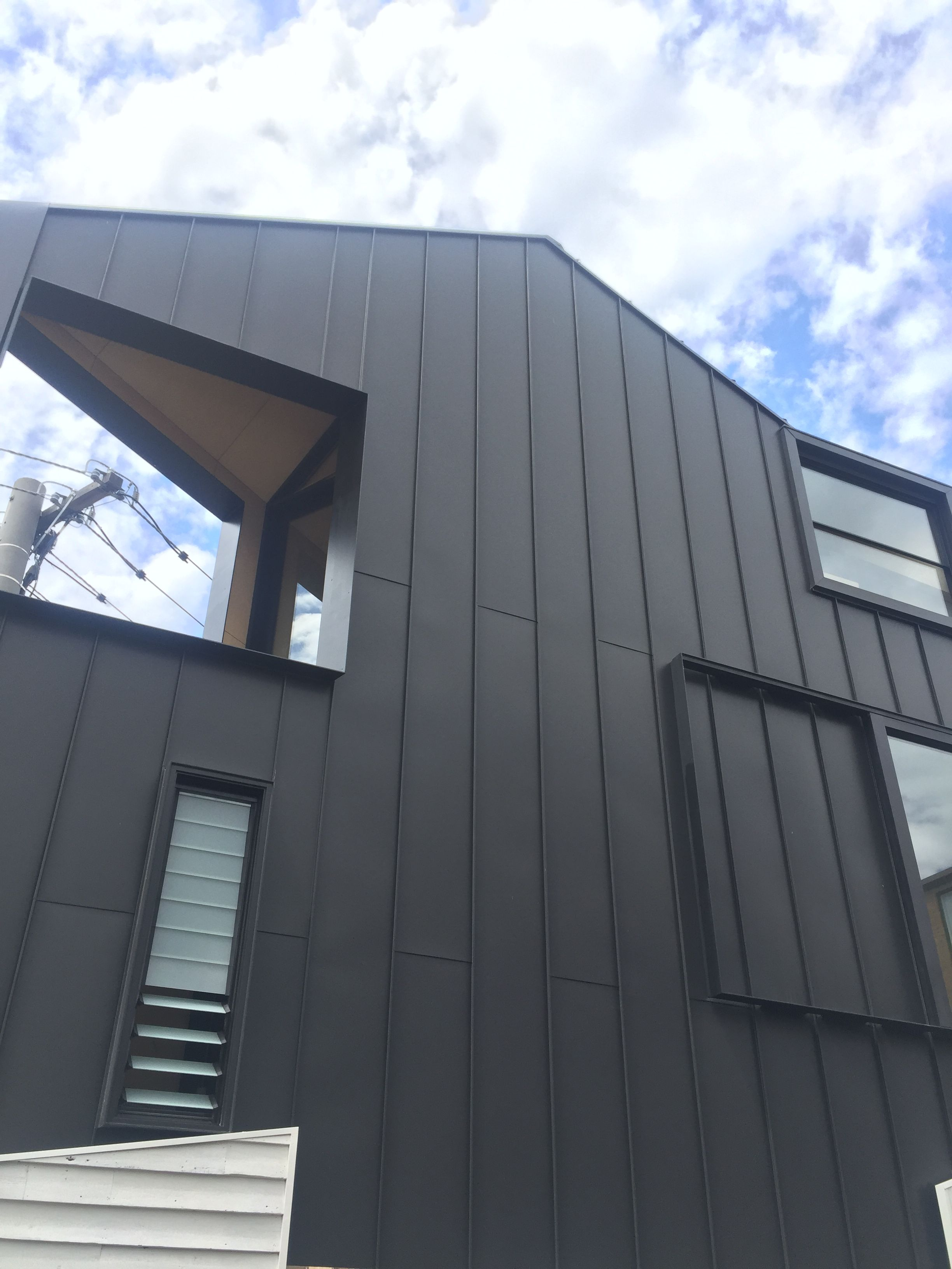 Best Acute House Albert Park An Amazing Little Project Black Aluminium Standing Seam Panels 400 x 300