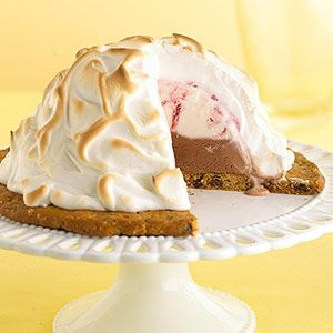 This classic dessert goes together easily, but looks impressive. Sponge cake is topped with Grand Marnier, ice cream, and meringue, then served with fresh berries.