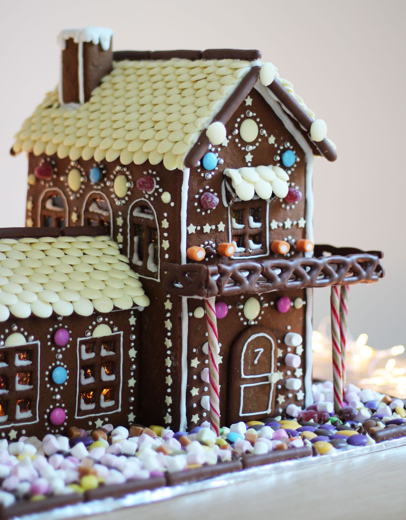 gingerbread house template two story  I love the chocolate dipped pretzel porch railing on this ...