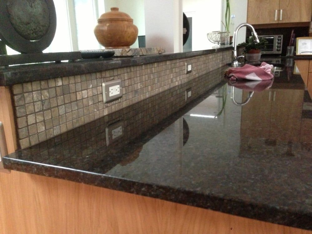 Photo Of Granite Works Countertops   Rockville, MD, United States. Coffee  Brown Countertops And Raised Bar