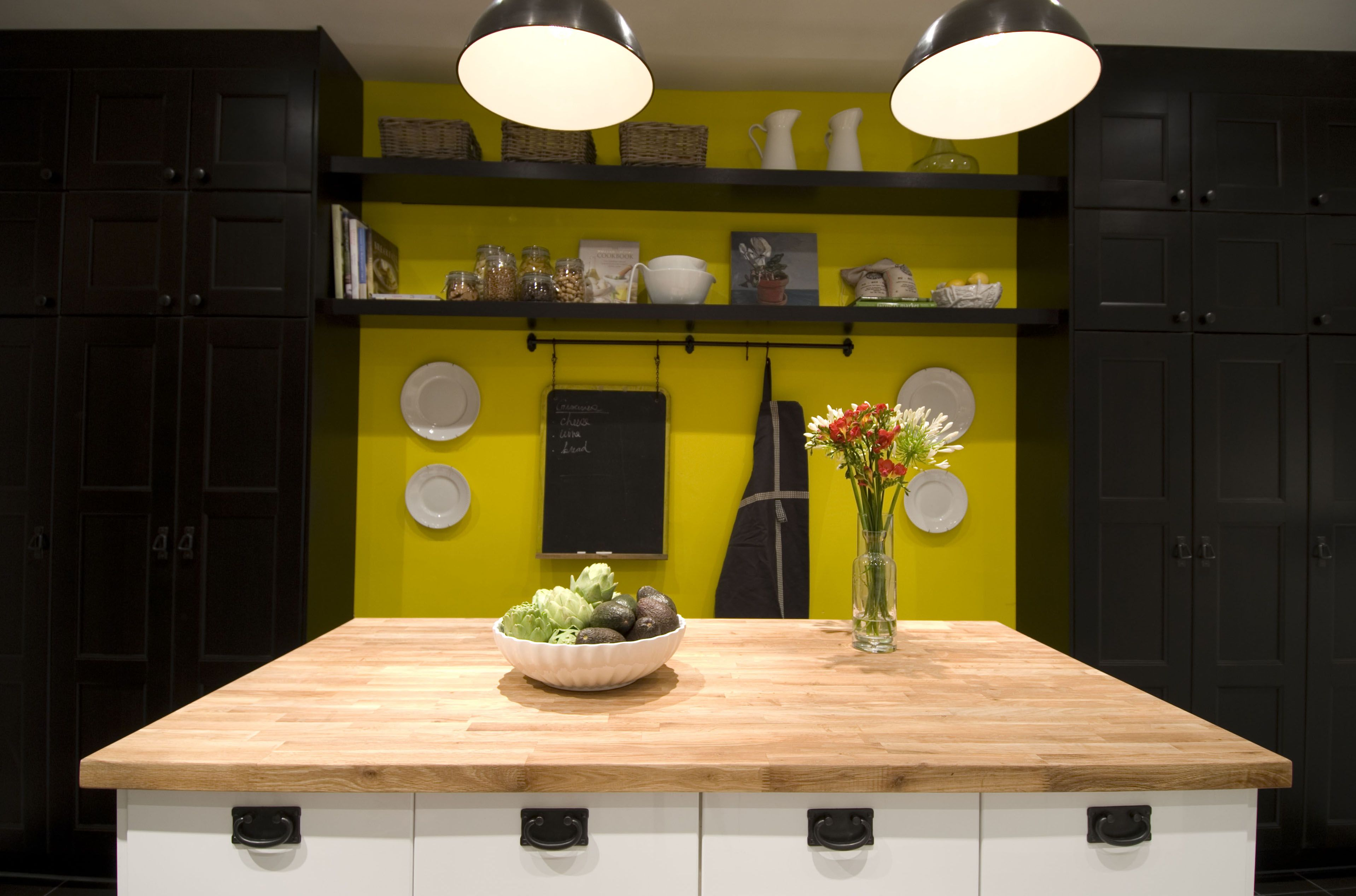 Yellow feature wall in kitchen, Income Property HGTV | Kitchen Ideas ...