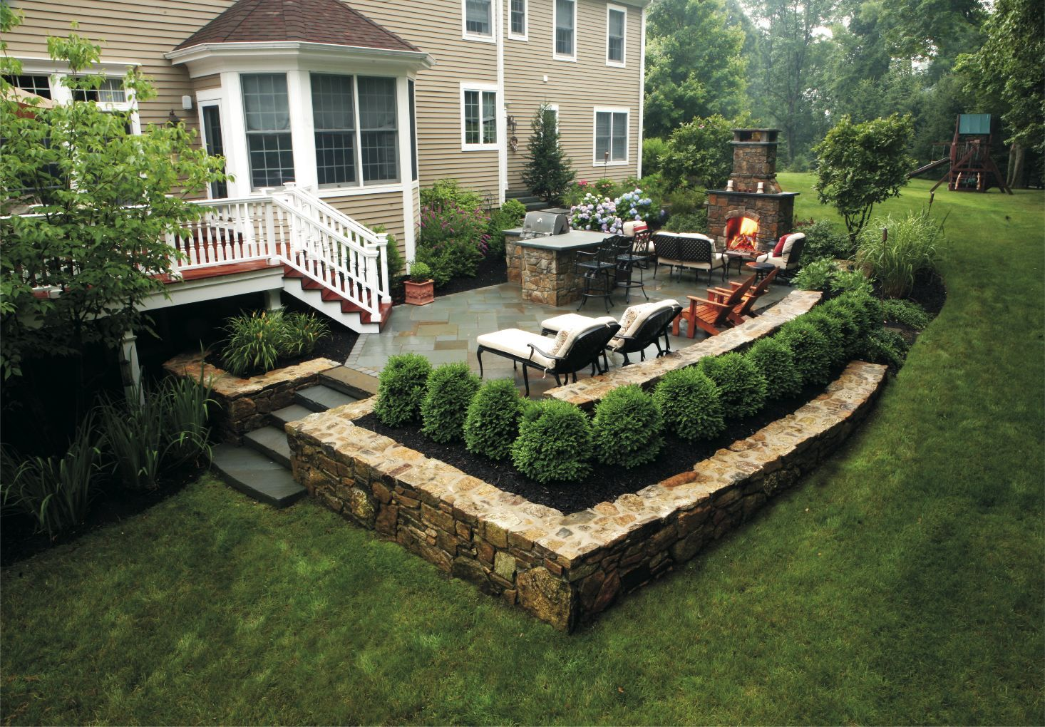 outdoor wood deck with stone outside member spotlight landscape