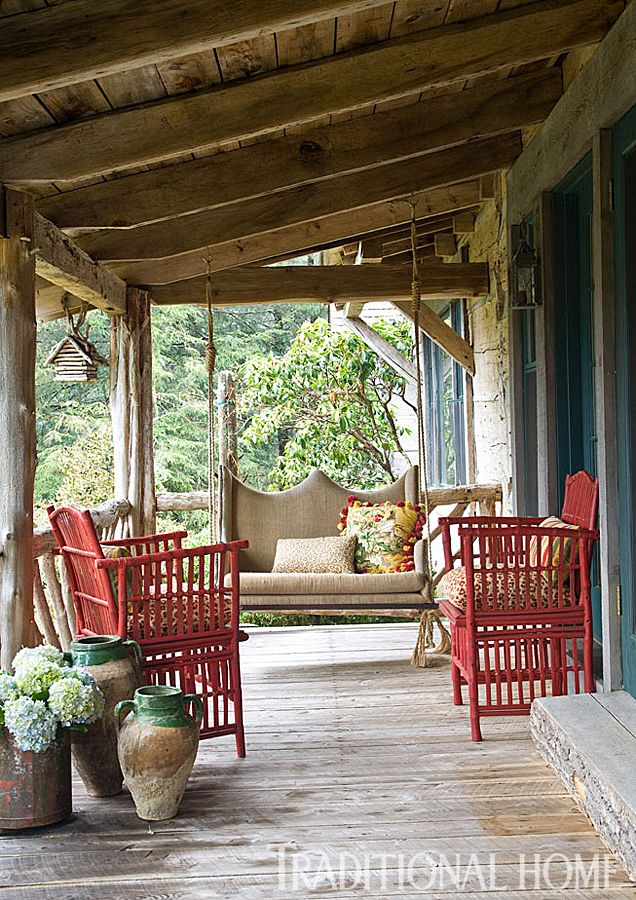 Rattan Chairs And A Custom Swing Covered In Burlap Offer Easy Seating On  The Front Porch