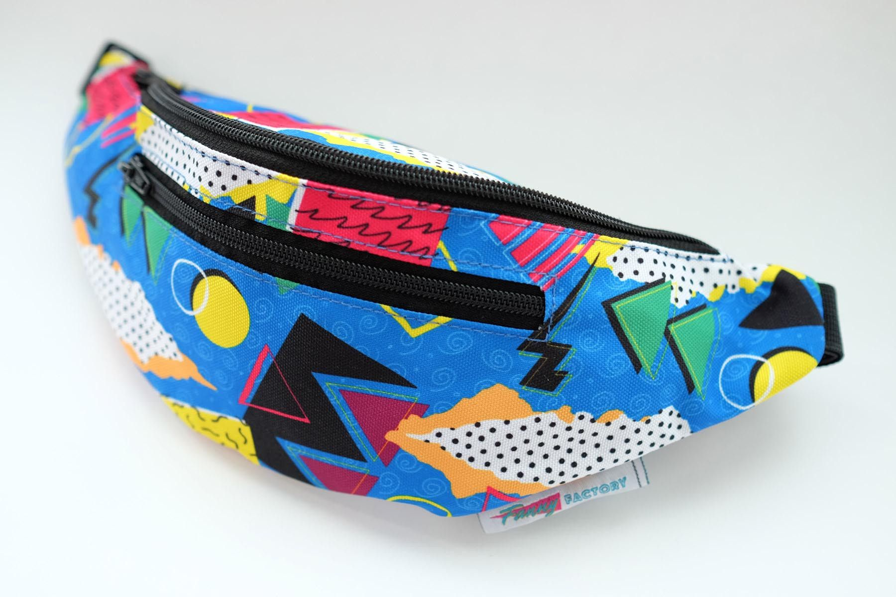 Saved by the Bell esque fanny pack with a blue background and fun retro prints