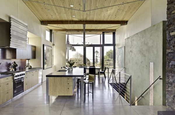 Large kitchen with high wooden ceilings and floor-to-ceiling windows