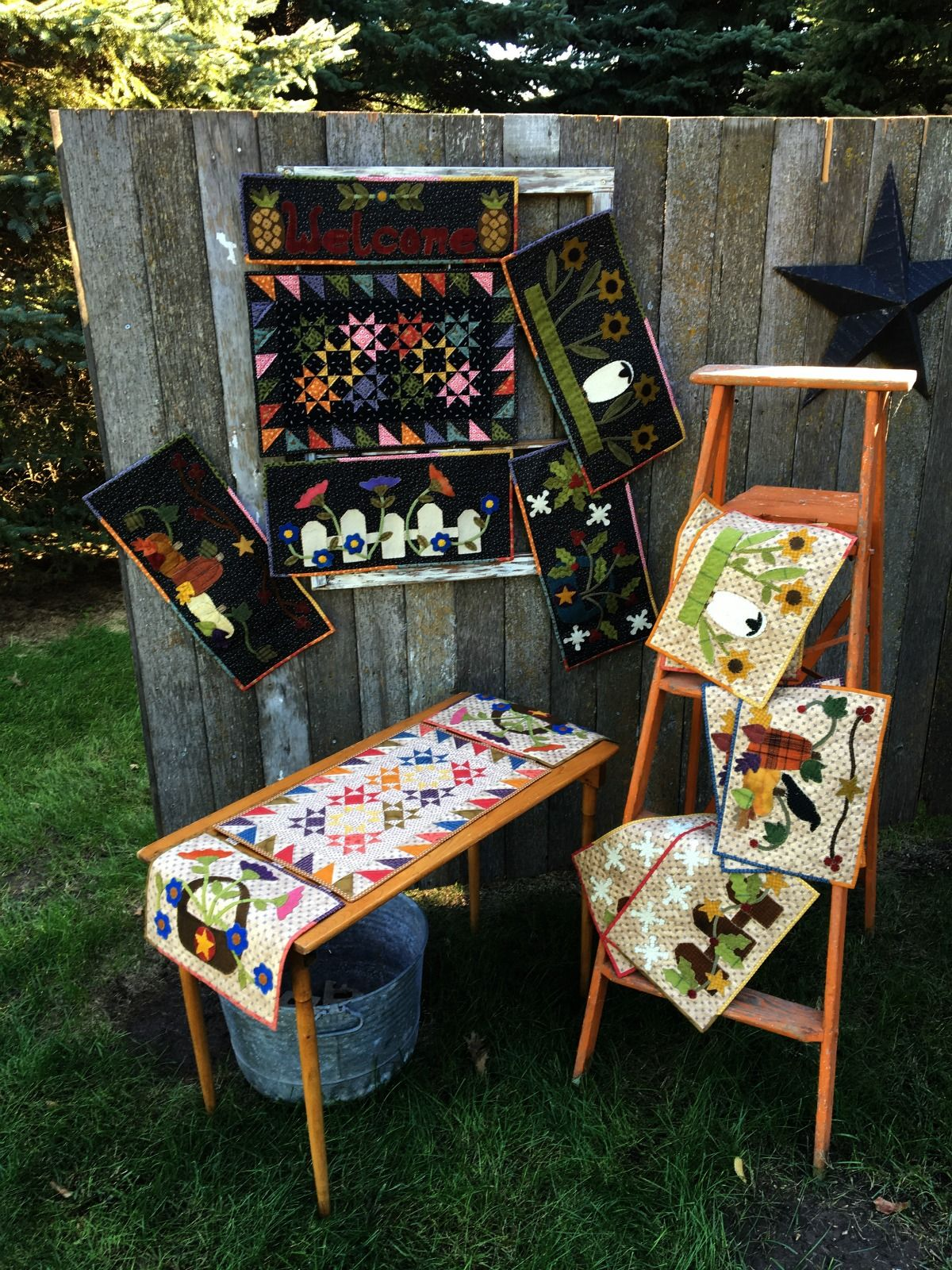 """Wool+appliqué+seasonal+panels+with+a+scrappy+pieced center.+Change+the+panels+to+celebrate+the+seasons in+your+home!+Wall+hanging+and+table+runner+instructions included.++Wall Hanging+22+x+30""""+an..."""