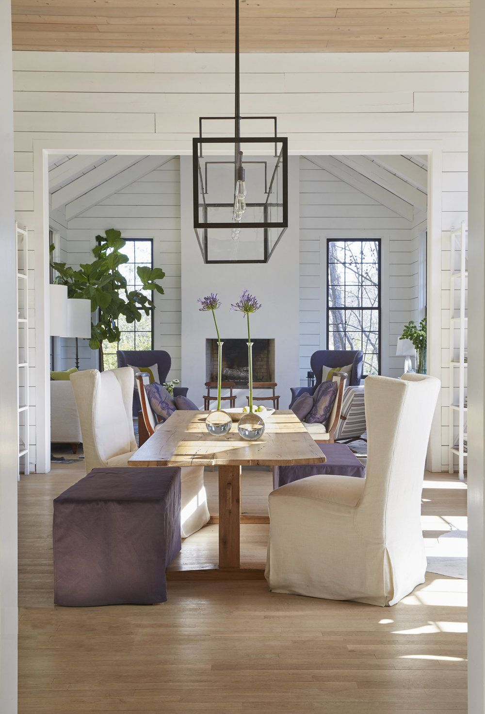 Modern rustic dining room table  ottoman n wing chair for dining  work space next to a seating