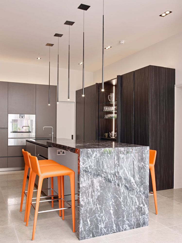 Eggersmann Design Black Veined Veneer With Stainless Steel Lava Lacquered Fronts Grigio Carnico Breakfast Bar And Nero Oluto Worktops Pendant Lights