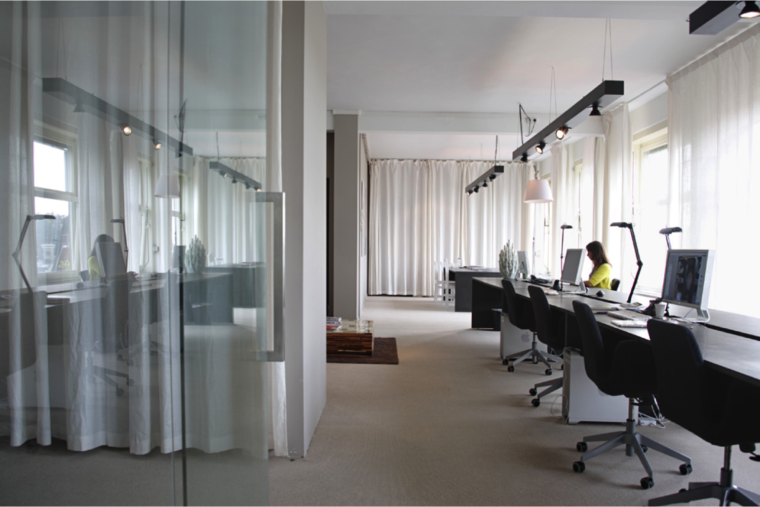 the flowing curtains add a softness to the space. | contemporary